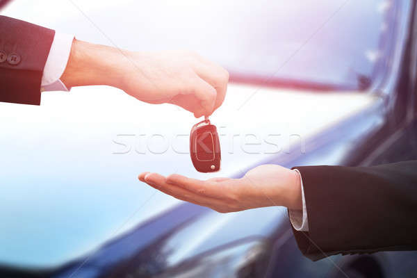 Male Hand Giving Car Key Stock photo © AndreyPopov