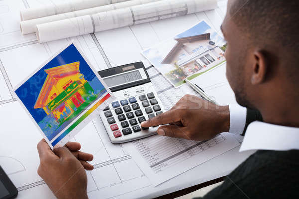 Architect Calculating Heat Temperature Stock photo © AndreyPopov