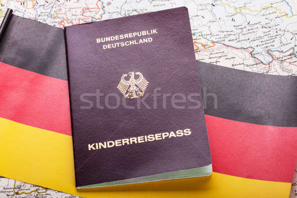 Passport On German Flag Stock photo © AndreyPopov