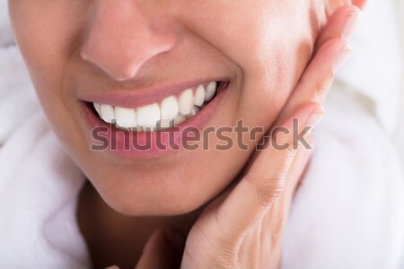 Young Woman Holding Toothache Stock photo © AndreyPopov