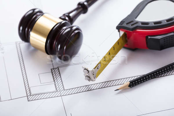 Gavel And Measuring Instrument On Blueprint Stock photo © AndreyPopov