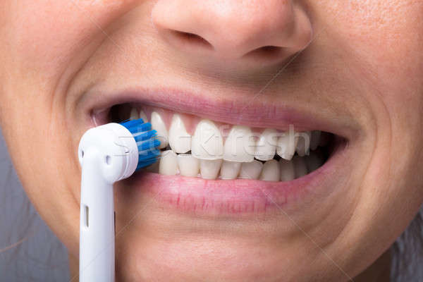 Tanden elektrische tandenborstel huis gezicht Stockfoto © AndreyPopov