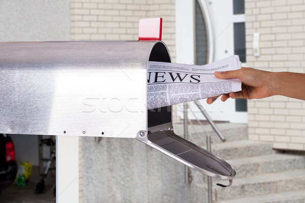 Person Removing Newspaper From Mailbox Stock photo © AndreyPopov