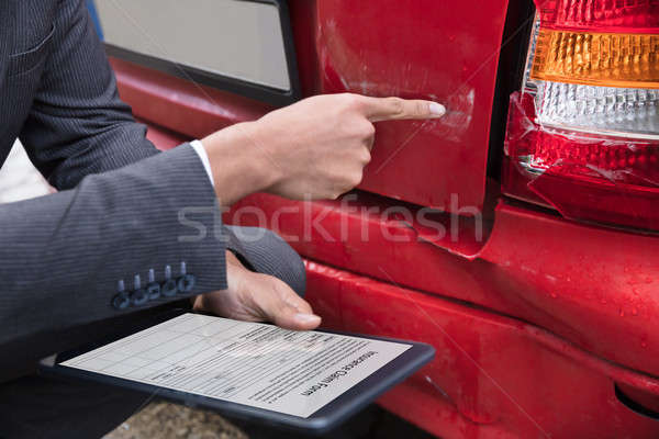 Insurance Agent Filling Insurance Claim Form On Digital Tablet Stock photo © AndreyPopov