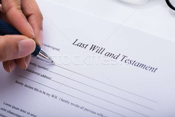 Person Filling Last Will And Testament Form Stock photo © AndreyPopov