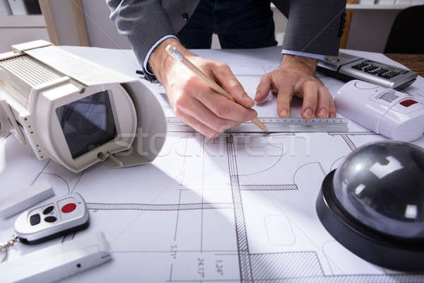 Architect Drawing Plan On Blueprint Stock photo © AndreyPopov
