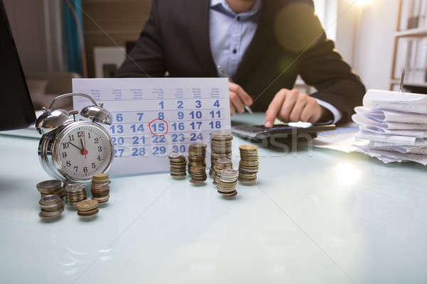 Munten kalender hand geld Stockfoto © AndreyPopov
