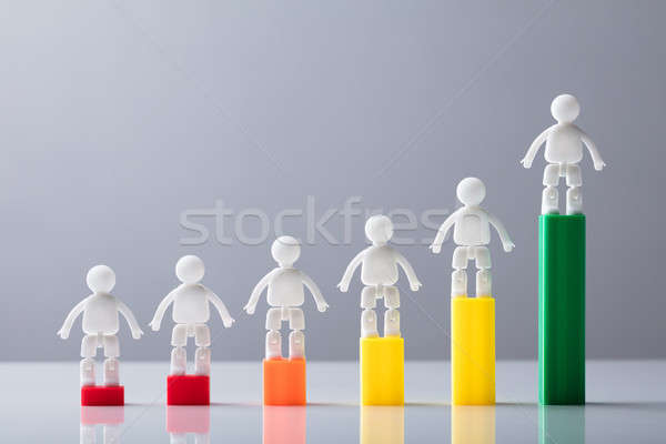 Human Figures Standing On Top Of Increasing Graph Stock photo © AndreyPopov