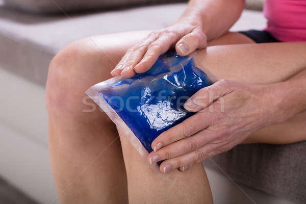Woman Applying Ice Bag On Her Knee Stock photo © AndreyPopov
