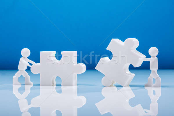 Two Human Figures Solving Jigsaw Puzzle Stock photo © AndreyPopov