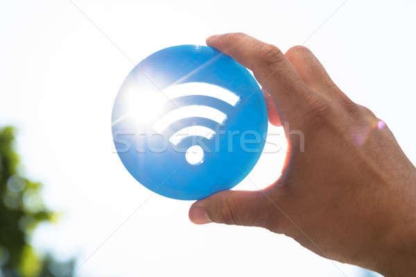 Person holding wireless icon Stock photo © AndreyPopov