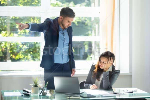 Businessman Firing Upset Female Employee Stock photo © AndreyPopov