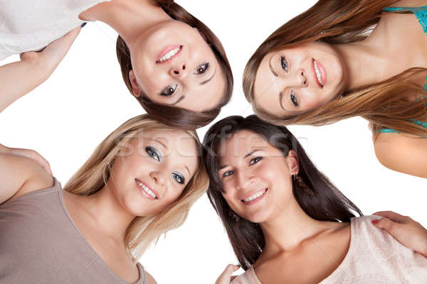 Stock photo: Four young woman looking down