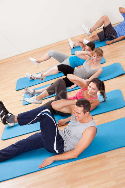 Group of people exercsning in a gym class Stock photo © AndreyPopov
