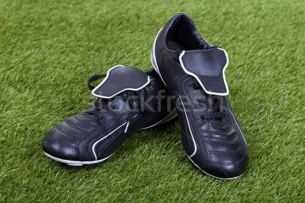 Soccer Shoes On Grass Field Stock photo © AndreyPopov
