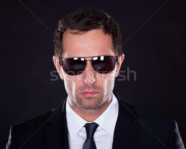 Portre genç güneş gözlüğü siyah iş adam Stok fotoğraf © AndreyPopov