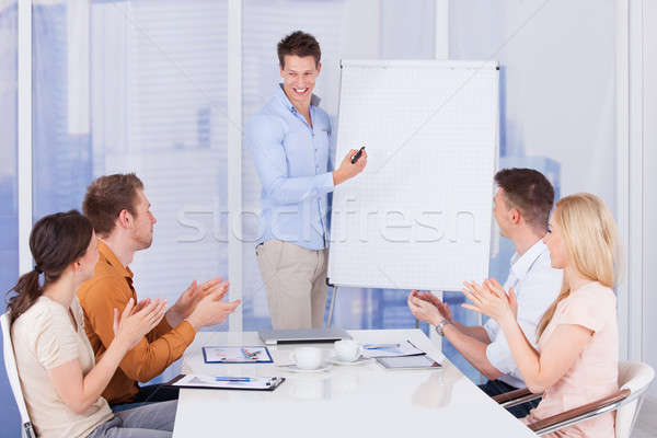 Business People Clapping For Colleague After Presentation Stock photo © AndreyPopov