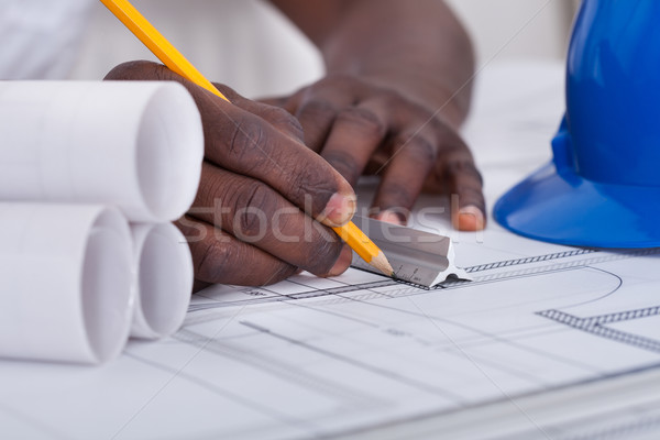 Stock photo: Draftsman Drawing Blueprint