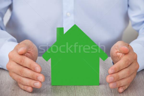 Kezek körül zöld modell ház asztal Stock fotó © AndreyPopov