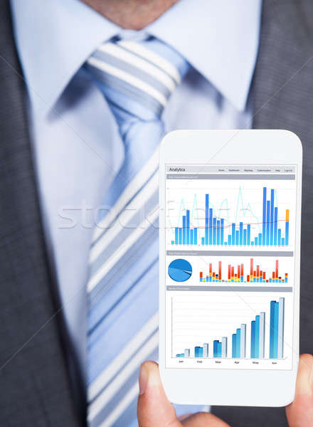 Businessman Showing Graphs On Smartphone Stock photo © AndreyPopov