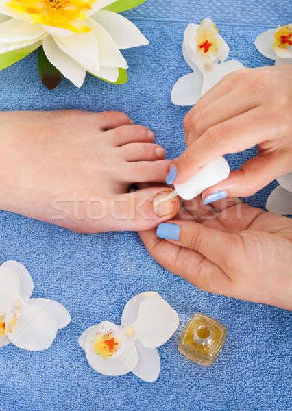 Pedicurist Applying Plain Varnish On Woman's Toenail Stock photo © AndreyPopov