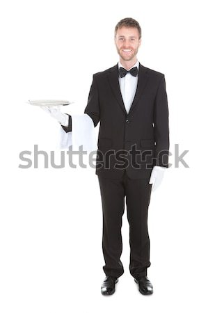Waiter Holding Champagne Bottle In Cooler Stock photo © AndreyPopov