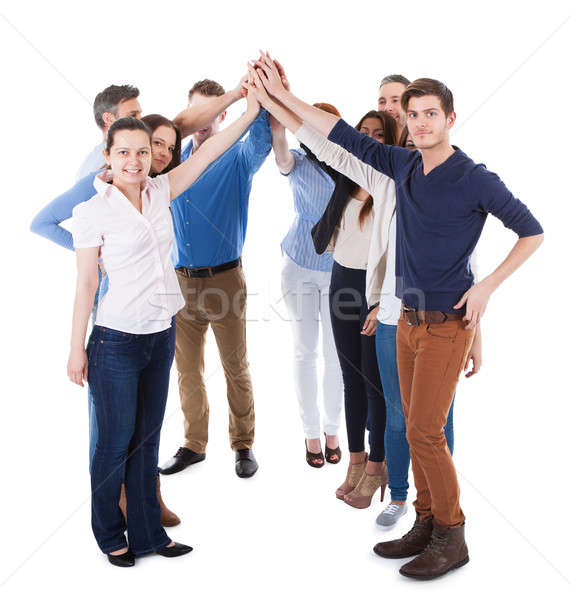 Diverse group of people making high five gesture Stock photo © AndreyPopov