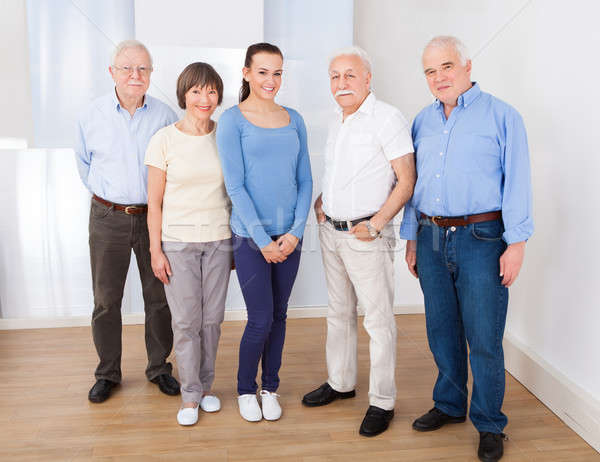 Happy Caregiver With Senior People Stock photo © AndreyPopov
