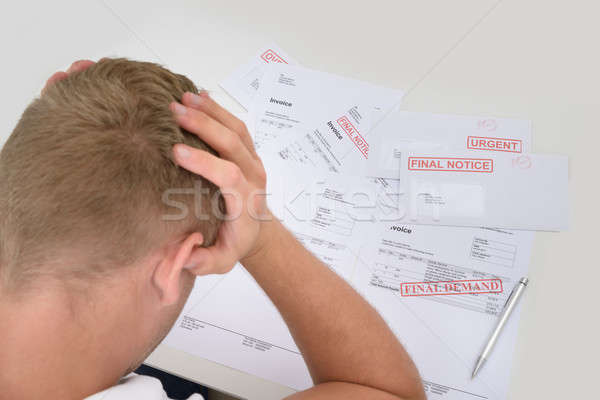 Frustrated Man With Unpaid Bills Stock photo © AndreyPopov