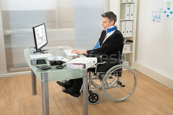 Disabled Businessman Using Computer Stock photo © AndreyPopov