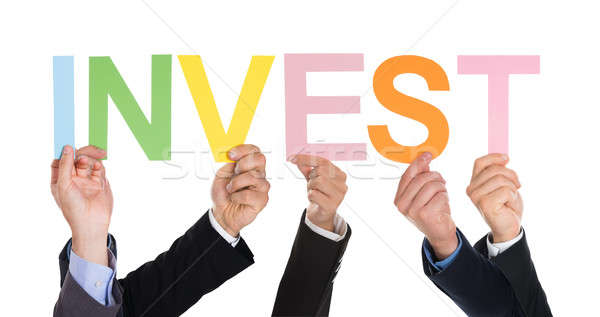 Group Of Businesspeople Hands With Text Invest Stock photo © AndreyPopov