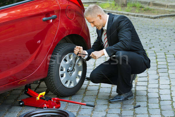 Man Changing A Wheel With Spanner Stock photo © AndreyPopov