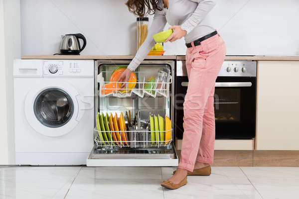 Woman Removing Bowls From Dishwasher Stock photo © AndreyPopov