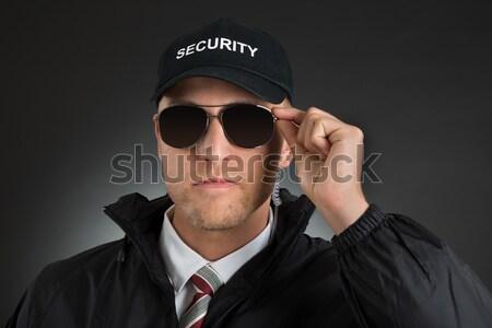 Male Bodyguard With Gun Stock photo © AndreyPopov