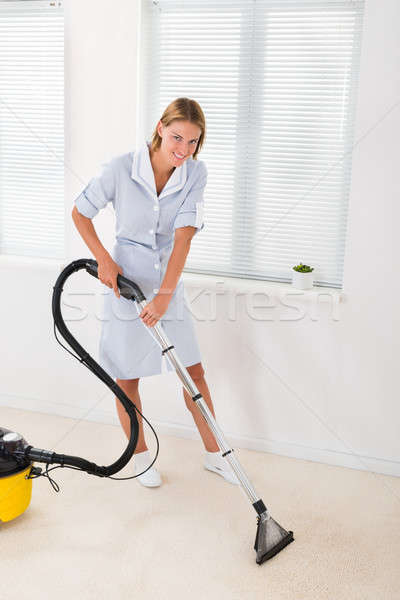 Female Maid Vacuuming Floor Stock photo © AndreyPopov