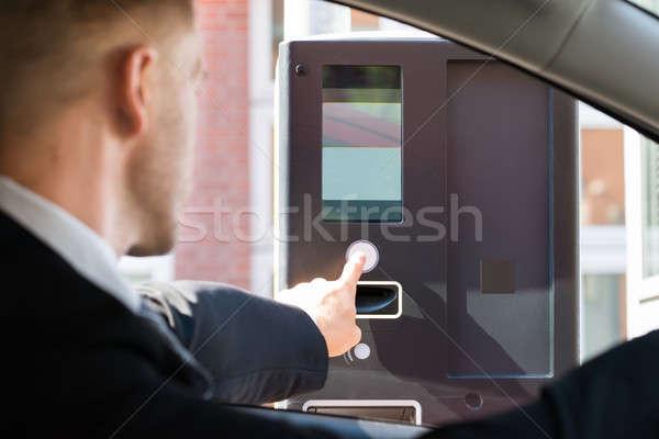 Személy parkolás gép illetmény ül autó Stock fotó © AndreyPopov