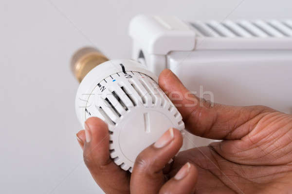 Személyek kéz tart radiátor termosztát közelkép Stock fotó © AndreyPopov
