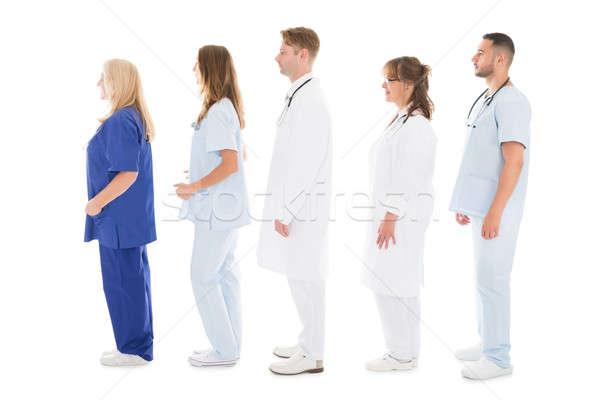 Foto stock: Vista · lateral · médicos · profesionales · pie