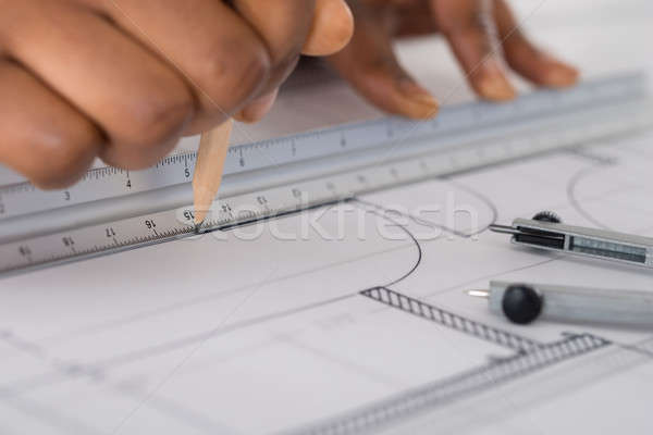 Person's Hand Drawing Blue Print Stock photo © AndreyPopov