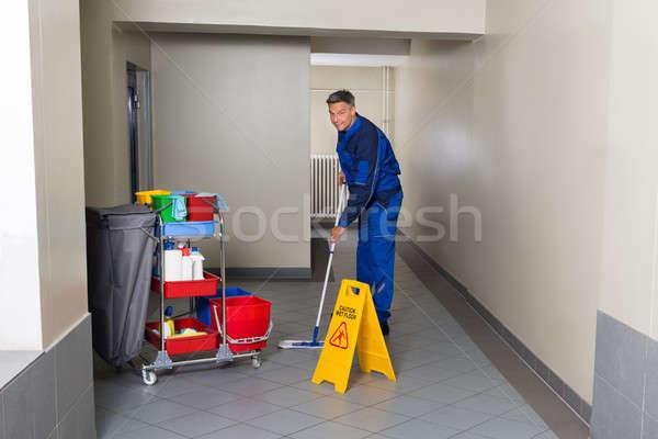 Сток-фото: мужчины · работник · метлой · очистки · коридор