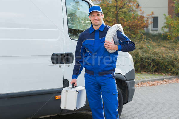 Confident Electrician With Cable Coil And Toolbox Stock photo © AndreyPopov