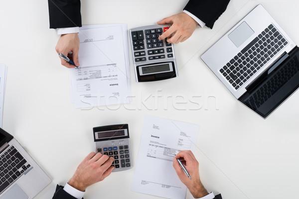 Empresários financiar secretária diretamente acima tiro Foto stock © AndreyPopov