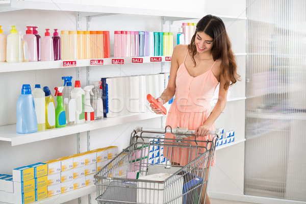 Woman Buying Beauty Product In Supermarket Stock photo © AndreyPopov
