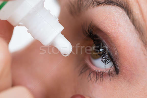 Close-up Of Person Pouring Drops In Eyes Stock photo © AndreyPopov