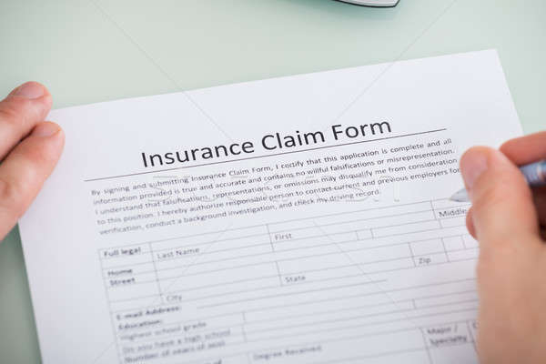 Person Hand Over Insurance Claim Form Stock photo © AndreyPopov