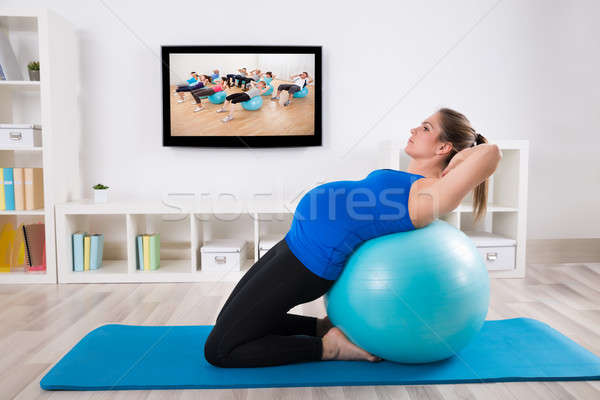 Pregnant Female Doing Workout On Fitness Ball Stock photo © AndreyPopov