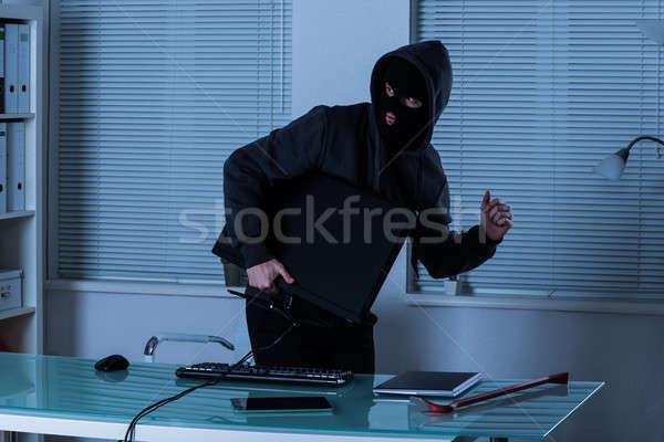Tolvaj lop számítógép iroda laptop digitális Stock fotó © AndreyPopov