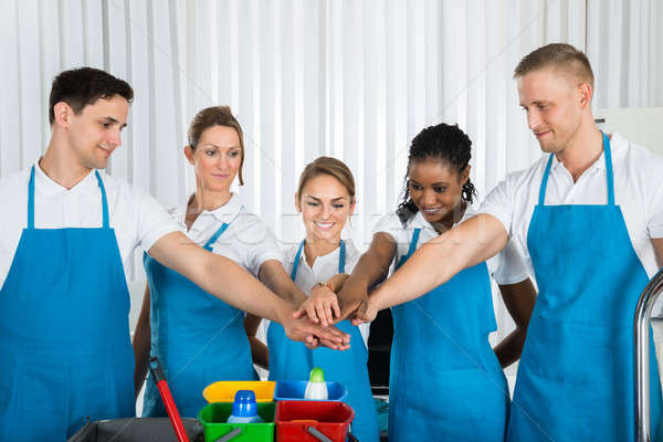 Happy Cleaners Stacking Hands Stock photo © AndreyPopov