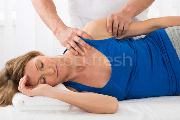 Person Giving Massage To Woman In Spa Stock photo © AndreyPopov