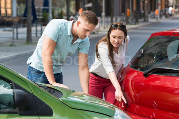 Woman Showing Man Car Collision Stock photo © AndreyPopov